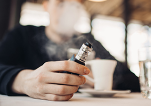 man using vape device