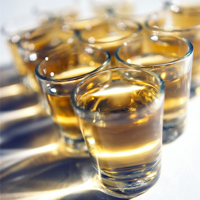Stock photo of whiskey in shot glasses